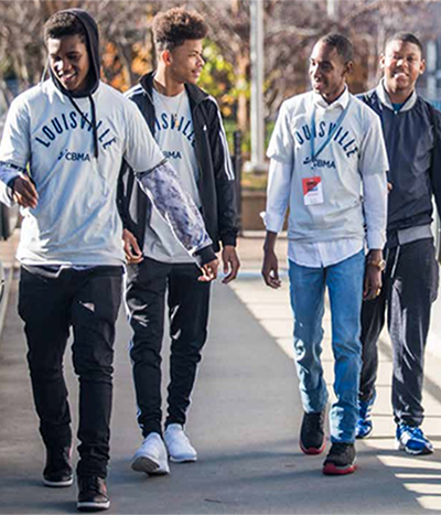 African American boys walking together in Louisville Campaign for Black Male Achievement t-shirts.